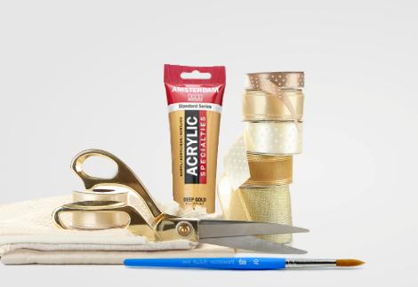 Scissors, paintbrush, decorative ribbon, Amsterdam deep gold acrylic paint